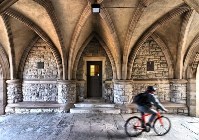 Student riding a bike through the Eggleston Tunnel on Virginia Tech's campus